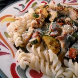 Chicken Zucchini Alfredo Recipe - Plenty of zucchini keeps the rich and creamy chicken Alfredo sauce from being too heavy. Whole wheat fettuccini completes this hearty meal.