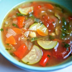 Quinoa and Vegetable Soup Recipe - Quinoa and kidney beans transform this vegetable soup into a hearty dinner perfect for any night of the week. Serve with a sprinkling of Parmesan cheese.