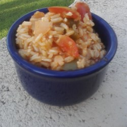 Spanish Brown Rice Recipe - Brown rice simmers with salsa, tomatoes, and garlic for a flavorful and wholesome spin on Spanish rice.