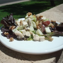 Marlene's Chicken Waldorf Salad Recipe - This colorful version of Waldorf salad includes two varieties of apples and grapes, pineapple, and celery tossed with chicken and a ranch dressing. It will be a popular dish for any occasion.