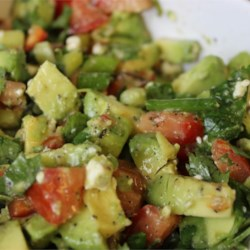 Cilantro, Avocado, Tomato, and Feta Salad Recipe - This fresh salad uses a large amount of cilantro and tomatoes, accompanied by green onions, jalapeno peppers, avocado, and feta cheese.