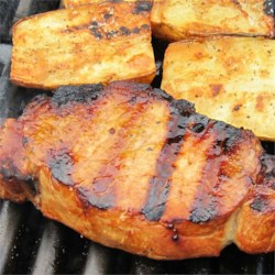 Best Grilled Pork Chops Recipe and Video - A simple marinade with soy sauce and lemon pepper seasoning add flavor to these pork chops meant to be grilled.