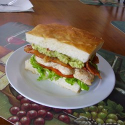 Pig Burger Recipe - This is a unique burger, invented in Australia. The burger consists of: Grilled chicken fillet, grilled bacon, lettuce and tomato on a toasted foccacia bun, with herbed mayo on the base and guacamole on the crown. The burger got its name due to the strange range of ingredients. They taste fantastic, however you may need a few napkins to clean up afterwards, depending on the amount of guacamole.