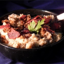 Garlic Mashed Potatoes with Eggplant Recipe - Roasted eggplant adds a smooth, rich quality to garlic mashed potatoes served with fried onions and crumbled bacon.