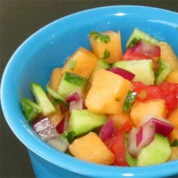 Cucumber Melon Salsa Recipe - This cold salsa is light and fresh, with unexpected flavors of cucumber and cantaloupe along with salsa ingredients like lime juice and fresh cilantro. Serve alone, as a garnish for chicken or fish, or as a dip with chips.