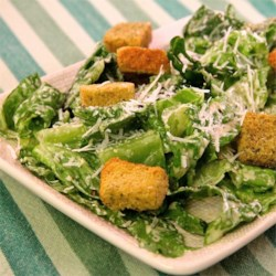 Easy Creamy Caesar Salad Dressing Recipe - Dress torn romaine lettuce with a quick-to-make creamy Caesar dressing using this salad recipe.