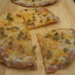 California Tortilla Pizzas Recipe - This is a delicious lunch or light dinner for two. Tortillas make the convenient crust for these crispy personal pizzas topped with fresh vegetables and cheese.