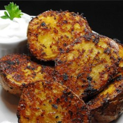 Oven Roasted Parmesan Potatoes Recipe and Video - Red potatoes are coated in seasoned Parmesan cheese and roasted into crispy Parmesan potatoes great as a side dish for brunch or dinner.