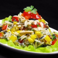 Bellepepper's Orzo and Wild Rice Salad Recipe - Orzo and wild rice are tossed with pecans, almonds, and a colorful variety of veggies in a homemade vinaigrette for a crowd-pleasing salad.