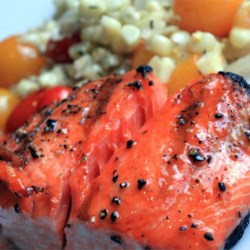 Lee's Salmon Baste Recipe - Grilling salmon is a summer favorite. This recipe offers a basting sauce with lemon juice, butter, and Catalina salad dressing to make your salmon even more delicious.
