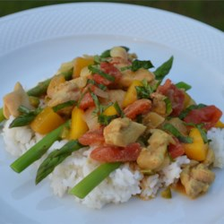 Crazy Spicy Chicken Recipe - Sweet mango adds a fruity taste to a chicken curry with tomatoes and warm Indian-inspired spices. Serve over basmati rice with asparagus for a meal that's filling but not heavy.