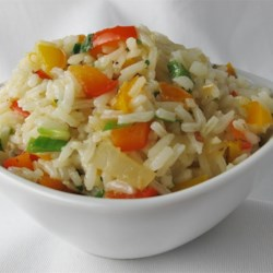 Sweet Bell Pepper Rice Recipe - Long grain rice gets an Italian-inspired twist in this colorful side dish with red and green bell pepper.