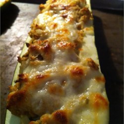 Stuffed Zucchini I Recipe - In this recipe zucchini are hollowed into 'boats' and stuffed with bread crumbs, Cheddar cheese, onion, parsley, egg and Parmesan cheese.  A hearty side dish or main meal.