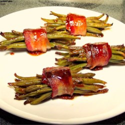 Sweet Green Bean Bundles Recipe - Green beans are wrapped in bacon and baked with butter, brown sugar and just a hint of garlic salt.