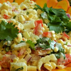 Confetti Corn Salad Recipe - This quick and tasty salad uses prepared ranch dressing with a mixture of corn, tomato, bell pepper, celery, and onion.