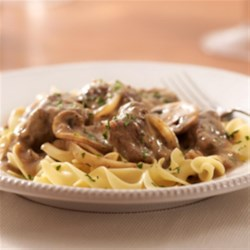 KRAFT RECIPE MAKERS Beef Stroganoff Recipe - Chunks of tender beef and mushrooms cooked in savory prepared sauces in a slow cooker are served over egg noodles for this easy, fuss-free dinner.