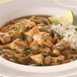 KRAFT RECIPE MAKERS Verde Chicken Chili Recipe - Chicken, bell peppers, and onions are simmered with beans in a delicious prepared sauce, served over rice, and drizzled with filling sauce.