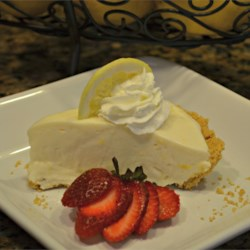 Lemonade Pie IV Recipe - Combine lemonade concentrate with softened cream cheese and sweetened condensed milk. Fold in whipped topping and spoon into a graham cracker crust. The fridge takes care of the rest.