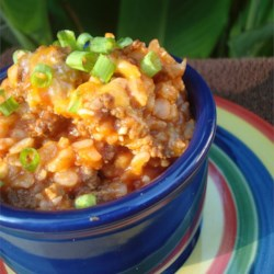 Rice Mess Recipe - A one-pot stovetop dish with rice and ground beef, cooked with tomato sauce, and topped with cheese.