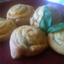 Stuffed Cheese Spirals Recipe - When unexpected guests arrive, a tube of crescent roll dough baked with Cheddar cheese and green onions makes a quick appetizer until you can figure out what to feed them next.