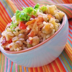 Bahamian Style Peas and Rice Recipe - Pigeon peas are a favorite in Latin America and the Caribbean, and this tomato-based rice dish is great way to enjoy them!