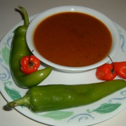 Bob's Habanero Hot Sauce - Liquid Fire Recipe - Using fewer habanero peppers can reduce the spiciness in this extremely hot habanero hot sauce.  The sauce works wonders as a pick-up for Bloody Mary drinks.  Flavors meld wonderfully and the sauce keeps nicely for a long time.  Warning: A dash is all you need and it is best to use gloves when handling the habanera peppers.