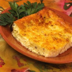 Crustless Caramelized Onions and Cheese Recipe - This crustless onion and cheese quiche is a delightful main dish perfect with a green salad.