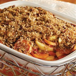 Glazed Apples and Sweet Potatoes with Pecan Streusel Topping Recipe - Apples, sweet potatoes, and raisins, glazed and baked then topped with a delicious streusel topping - a cozy treat on a cold night!