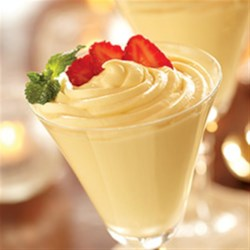 Lemon Mousse with Berries Recipe - A light and lovely mousse flavored with lemon is topped with fresh berries and an optional mint garnish. Serve it in tall stemmed glasses for an elegant finish.