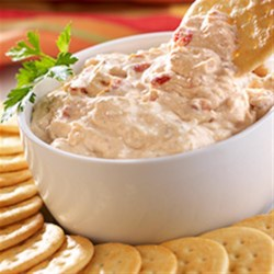 Zesty Pepper and Onion Dip Recipe - Try this super-simple tangy pepper and onion dip the next time you need an easy appetizer. All it takes is prepared pepper and onion relish, cream cheese, and some crackers to serve with it.