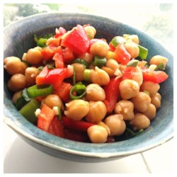 Cumin and Coriander Chickpea Salad Recipe - A garlicky olive oil and vinegar dressing graces a hearty mix of garbanzo beans and yellow bell peppers.