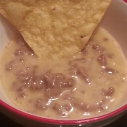 Taco Queso Dip Recipe - Make a taco-seasoned cheese and beef dip with this recipe designed for ideal tortilla chip dippin'! There's even beer in it!