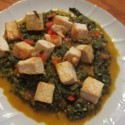 Palak Paneer (Indian Spinach and Paneer) Recipe - Cubes of paneer simmer in a smooth spinach puree, fragrant with cumin seeds, ground coriander, ground turmeric, and curry powder.