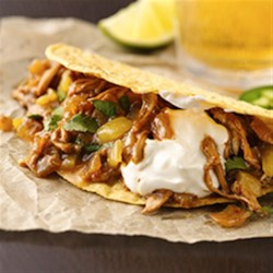 Beer-Braised Chicken Tacos Recipe - Enjoy this Mexican-style dinner featured with chicken, beer, Old El Paso(R) taco shells and green chiles--a wonderful meal.