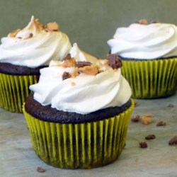 Peanut Butter Cup Chocolate Cupcakes with Toasted Peanut Butter Meringue Frosting Recipe - What could improve upon a delicious chocolate cupcake? A peanut butter cup in the center and lightly caramelized peanut butter frosting!