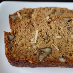 Mango Bread Recipe - This quick bread is spiked with mango, coconut, and walnuts.