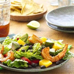 Shrimp and Mango Taco Salad Recipe - Try this delicious and fresh twist on the traditional taco salad using shrimp and mangoes. It is beautiful and comes to the table very quickly!