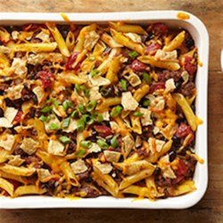 Mexican Bison Bake with Cilantro-Lime Cream Recipe - Browned ground bison with tomatoes and penne pasta gets a Mexican-inspired twist with cumin, oregano, and black beans in this easy weeknight casserole.