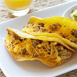 Ground Bison Breakfast Tacos with Pineapple Salsa Recipe - Lots of spices in this ground bison and egg omelet make for a great taco filling, and the pineapple salsa with fresh cilantro is the perfect topping.