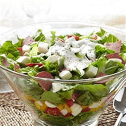 Italian Layered Salad with Bison Pepperoni Recipe - Layers of crisp, colorful greens and veggies topped with chopped bison sausage with pepperoni seasoning and a creamy basil dressing make a perfect lunch or dinner side salad.