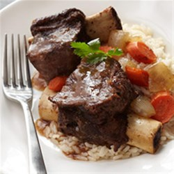 Asian Bison Short Ribs Recipe - Sesame oil, soy sauce, orange juice, and cayenne pepper enhance the flavor of these rich bison ribs cooked long and slow with vegetables.