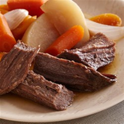 Beer-Braised Bison Brisket with Root Vegetables Recipe - Slowly braised with root vegetables in a beer and horseradish sauce, bison makes a wonderfully hearty meal.
