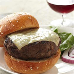 Stuffed Bison Burgers with Caramelized Figs and Shallots Recipe - Figs simmered in pomegranate juice make a gourmet filling for impressive stuffed and grilled bison burgers served on toasted French bread with melted Gruyere cheese.