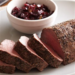 Bison Tenderloin with Cherry-Onion Chutney Recipe - A roasted bison tenderloin is served topped with a fruity cherry and onion chutney with the tang of balsamic vinegar in this elegant main dish.