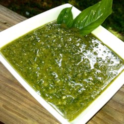 Simple Garlic and Basil Pesto Recipe - This recipe is something that you can make quickly and easily using a blender. Everything you need is easy to find in your local supermarket. This paste is great for putting on or in meat and pastas, or with cottage cheese in stuffed pasta shells. Once I start making this, the orders from friends and family keep coming in. For best taste, pesto should be heated up in the meal it's being prepared with.