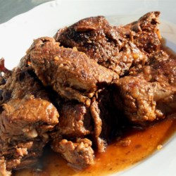 Tanya's Boneless Short Ribs Recipe - Boneless, simmering short ribs broiled then thrown in the oven. Easy as 1-2-3. Hubby LOVES this dish and whines when I don't make it. If you like LOTS of sauce double the liquid amounts. Great for indoor cooking nights....
