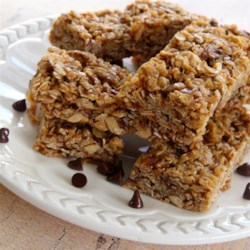 Granola Bars Recipe - Toasted coconut and oats mix in a sauce made with honey and peanut butter for these granola bars.