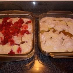 Cherry Cobbler II Recipe - Melted butter is topped with a sweet biscuit dough and lots of cherry pie filling. This tasty cobbler is then popped into the oven and baked in a 9x13-inch pan until golden brown. This cobbler will serve twelve.