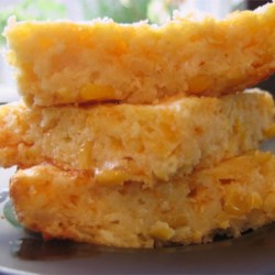 Cornbread Casserole Recipe - A deliciously moist and dense cornbread with a topping of melted cheese.