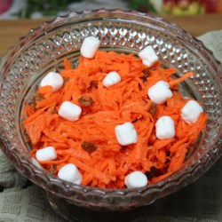 Citrus Carrot Salad Recipe - Shredded carrots are tossed with lemon and lime juice and topped with marshmallows creating a delightful citrus carrot salad perfect for picnics.